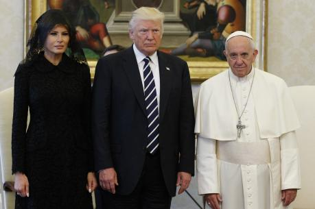 Pope Francis poses with U.S. President Donald Trump and his wife, Melania, during a private audience at the Vatican May 24. (CNS photo/Paul Haring) See POPE-TRUMP-MEET May 24, 2017.