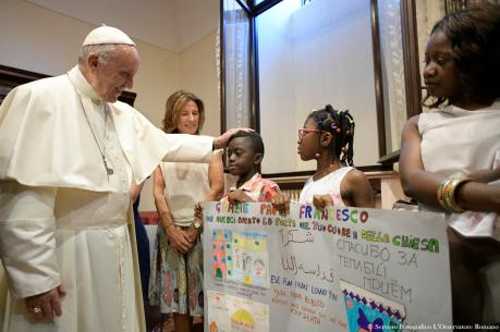 Pope Francis greets young refugees during a conference on families and adolescent education at Rome's Basilica of St. John Lateran on June 19. (CNS photo/L'Osservatore Romano via Reuters)