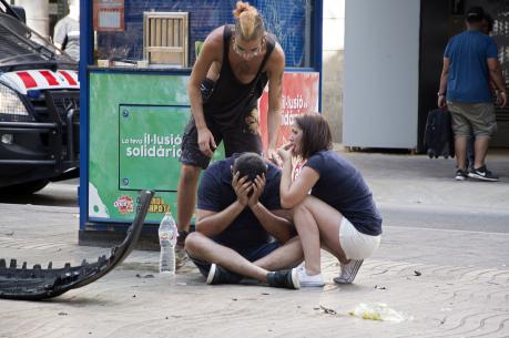 Injured people react after a van crashed into pedestrians in the Las Ramblas district of Barcelona, Spain, Aug. 17. Terrorists killed at least 12 and injured more than 50 others. (CNS photo/David Armengou, EPA)