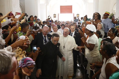 Pope Francis greets people as he arrives to visit the Shrine of St. Peter Claver in Cartagena, Colombia, on Sept. 10. (CNS photo/Paul Haring)