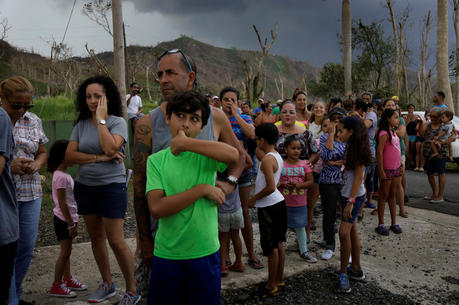 Residents wait for soldiers in helicopters to deliver food and water Oct. 13 during recovery efforts following Hurricane Maria in San Lorenzo, Puerto Rico. (CNS photo/Lucas Jackson, Reuters)
