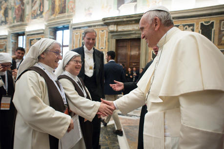 Pope Francis greets a French nun with Down Syndrome during an audience at the Vatican on Oct. 21, 2017. (CNS photo/L'Osservatore Romano)