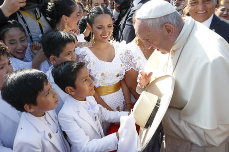 A boy presents a hat to Pope Francis upon his arrival at the international airport in Trujillo, Peru, Jan. 20. (CNS photo/Paul Haring)