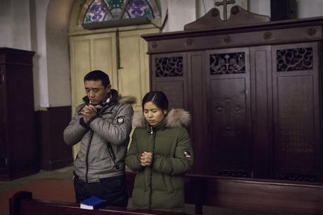 People pray during morning Mass Jan. 30 in Cathedral of the Immaculate Conception in Beijing. (CNS photo/Roman Pilipey, EPA)
