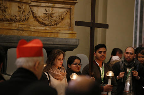 Youths attending a pre-synod meeting participate in the Way of the Cross at the Basilica of St. John Lateran in Rome on March 23. (CNS photo/Paul Haring)