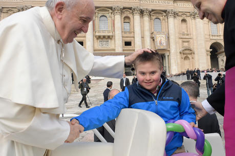 Pope Francis greets Peter Lombardi, 12, of Columbus, Ohio, after the boy rode in the popemobile during his general audience in St. Peter's Square at the Vatican March 28. Receiving a kiss from the pope was a wish come true for Peter, who has Down syndrome and has survived leukemia. (CNS photo/Vatican Media)