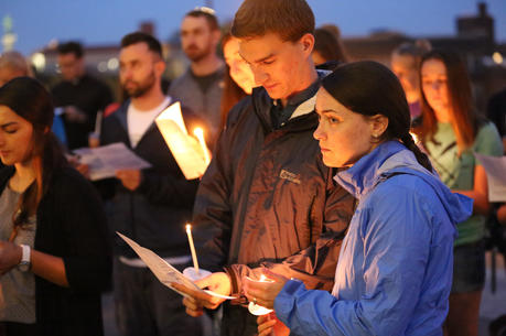 "Brett and Bridget Hutchinson of St. Thomas More in St. Paul, Minn., pray with other young adults gathered on the steps of the Cathedral of St. Paul Aug. 20 during a vigil called ""Evening Prayer for the Survivors of Clerical Abuse and the Healing of the Church."" (CNS photo/Dave Hrbacek, The Catholic Spirit)"