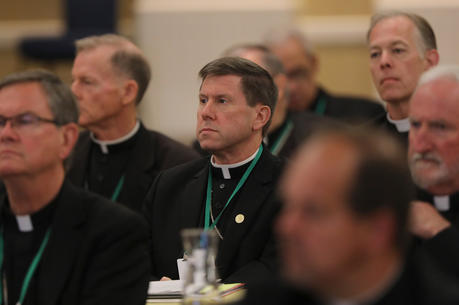 Bishop J. Mark Spalding of Nashville, Tenn., center, listens to a speaker on the first day of the spring general assembly of the U.S. Conference of Catholic Bishops in Baltimore June 11, 2019. (CNS photo/Bob Roller)