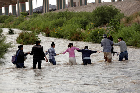 Migrants from Central America seeking asylum in the United States cross the Rio Grande near Ciudad Juarez, Mexico, on June 11. (CNS photo/Jose Luis Gonzalez, Reuters)