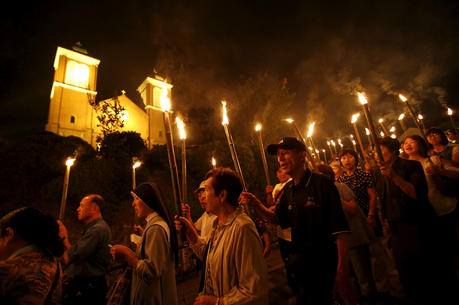 Catholics holding torches leave Urakami Cathedral in Nagasaki, Japan, Aug. 9, 2015, after praying for victims of the 1945 atomic bombing. Pope Francis will finally fulfill his desire to be a missionary to Japan when he visits the country, as well as Thailand, Nov. 20-26, 2019, the Vatican announced Sept. 13. (CNS photo/Toru Hanai, Reuters)