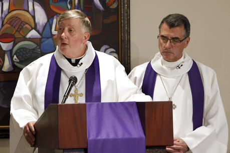Bishop Mitchell T. Rozanski of Springfield, Mass., addresses the congregation alongside Lutheran Bishop Donald Kreiss, chair of the Evangelical Lutheran Church in America's ecumenical and interreligious relations committee, during a March 2, 2017, prayer service in Chicago. (CNS photo/Karen Callaway, Chicago Catholic)