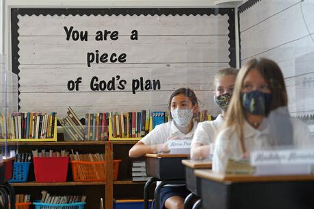 Sixth-graders sit at their desks on the first day of classes of the new academic year at Our Lady of Victory School in Floral Park, N.Y., on Sept. 8. (CNS photo/Gregory A. Shemitz)