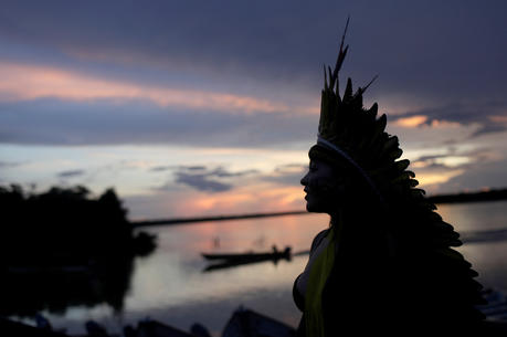 A leader of the Celia Xakriaba peoples walks along the banks of the Xingu River, a tributary of the Amazon, in Brazil's Xingu Indigenous Park on Jan. 15, 2020. (CNS photo/Ricardo Moraes, Reuters)