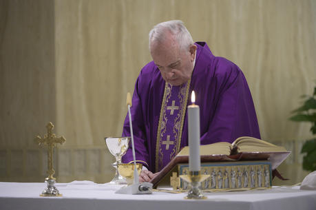 Pope Francis celebrates Mass in the chapel of the Domus Sanctae Marthae at the Vatican March 27, 2020. (CNS photo/Vatican Media)