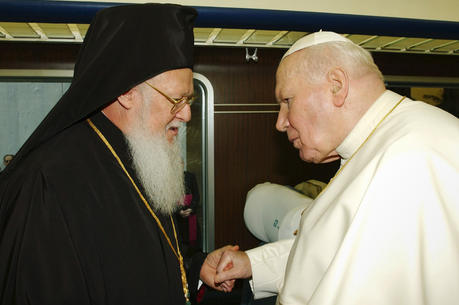 "St. John Paul II greets Ecumenical Patriarch Bartholomew in 2002. Marking the 25th anniversary of St. John Paul II's encyclical on Christian unity, Pope Francis said he shares ""the healthy impatience"" of those who think more can and should be done, but he also insisted that Christians must be grateful for the progress made. (CNS photo/Reuters)"