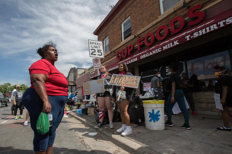 A woman in Minneapolis expresses her anger and frustration on May 28, at the site where George Floyd was pinned down on May 25 by a police officer; he was later pronounced dead at a local hospital. (CNS photo/Dave Hrbacek, The Catholic Spirit)