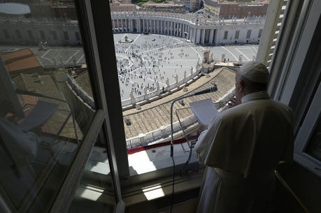 Pope Francis greets the faithful from the window of his studio overlooking St. Peter's Square on May 31. The pope led the Sunday prayer from his window for the first time in three months, after the square was reopened. (CNS photo/Vatican Media)