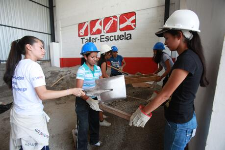 Young women put to work at a Fe y Alegria program in Soyapango, El Salvador. The training program is one of about 20 across Central America that partner with YouthBuild, a program of Catholic Relief Services that trains young people in various work skills so they can avoid emigrating. (CNS photo/Oscar Leiva, Silverlight for Catholic Relief Services)