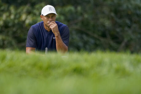 Tiger Woods, of the United States, waits to hit on the 13th hole during the first round of the US Open Golf Championship, Thursday, Sept. 17, 2020, in Mamaroneck, N.Y. (AP Photo/Charles Krupa)