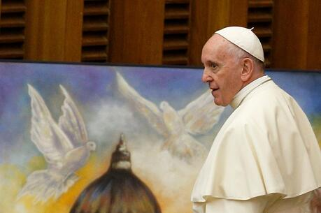 Pope Francis walks past artwork showing the dome of St. Peter's Basilica and two doves during his general audience at the Vatican in this Aug. 8, 2018, file photo. (CNS photo/Paul Haring)