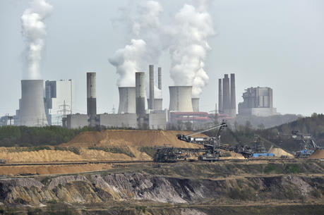 Giant machines dig for brown coal at the open-cast mining Garzweiler in front of a power plant near the city of Grevenbroich in western Germany in April 2014. (AP Photo/Martin Meissner, File)