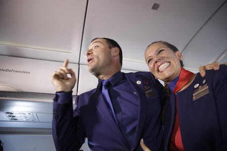 Flight attendants Carlos Ciuffardi, left, and Paola Podest, talk with journalists during a flight from Santiago, Chile, to Iquique, Chile, after Pope Francis married them in-flight early Thursday, Jan. 18, 2018. (AP Photo/Alessandra Tarantino)