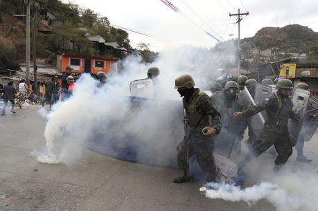 Supporters of opposition presidential candidate Salvador Nasralla clash with military police in the Policarpo Paz Garcia neighborhood of Tegucigalpa, Honduras, on Jan. 20, 2018. Following a disputed election marred by irregularities, incumbent President Juan Orlando Hernandez was declared the victor and will be inaugurated on Jan. 27. The opposition does not recognize Hernandez's victory and are protesting against the result. (AP Photo/Fernando Antonio)