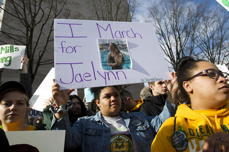 "Ayanne Johnson, a student from Great Mills High School in southern Maryland, holds up the photograph of her classmate Jaelynn Willey during the ""March for Our Lives"" rally in Washington on March 24. Willey was killed by a classmate this week at her school. (AP Photo/Jose Luis Magana)"