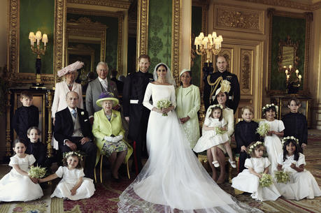 An official wedding photo of Britain's Prince Harry and Meghan Markle, center, in Windsor Castle, Windsor, England. Others in photo from left, back row, Jasper Dyer, Camilla, Duchess of Cornwall, Prince Charles, Doria Ragland, Prince William; center row, Brian Mulroney, Prince Philip, Queen Elizabeth II, Kate, Duchess of Cambridge, Princess Charlotte, Prince George, Rylan Litt, John Mulroney; front row, Ivy Mulroney, Florence van Cutsem, Zalie Warren, Remi Litt. (Alexi Lubomirski/Kensington Palace via AP)