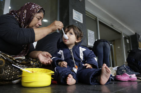 A migrant women from Iraq feeds her grandson in front of the railway station in Sarajevo, Bosnia, on June 19, 2018. Some hundreds of migrants have been camping at the railway station in the Bosnian capital of Sarajevo waiting for an opportunity to get to Croatia and Western Europe. (AP Photo/Amel Emric)