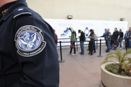 In this Dec. 10, 2015, file photo, pedestrians crossing from Mexico into the United States at the Otay Mesa Port of Entry wait in line in San Diego. (AP Photo/Denis Poroy, File)