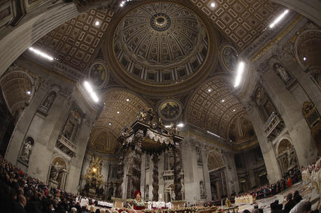 Pope Francis celebrates Christmas Eve Mass in St. Peter's Basilica in 2019. Vatican prosecutors have ordered the seizure of documents and computers from the administrative offices of St. Peter's Basilica in an apparently new investigation into financial irregularities in the Holy See. (AP Photo/Alessandra Tarantino)