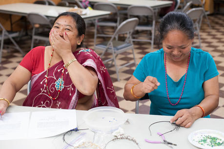 A beading session at Loom Chicago. Photo courtesy of Catholic Charities of the Archdiocese of Chicago.