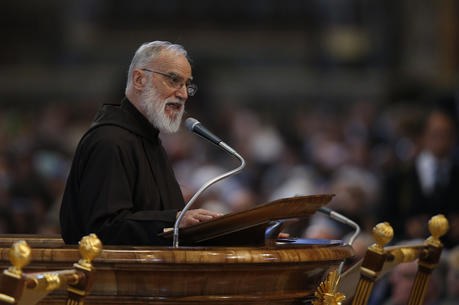 Capuchin Franciscan Father Raniero Cantalamessa, preacher of the papal household, gives the homily during the Good Friday service led by Pope Francis in St. Peter's Basilica at the Vatican April 14. (CNS photo/Paul Haring)