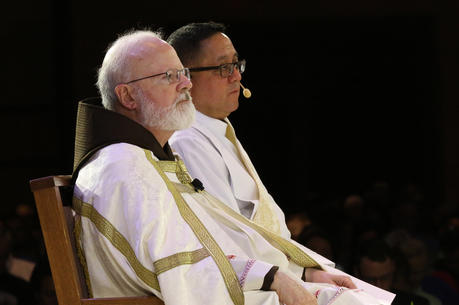 Boston Cardinal Sean P. O'Malley and Deacon Bernie Nojadera, executive director of the U.S. bishops' Secretariat for Child and Youth Protection, are pictured during the 2017 Catholic convocation in Orlando, Fla.  (CNS photo/Bob Roller)