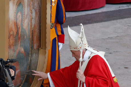 Pope Francis touches a Marian icon as he leaves at the end of a vigil, ahead of Pentecost Sunday, at the Vatican June 8, 2019. (CNS photo/Remo Casilli, Reuters)