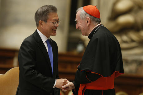South Korean President Moon Jae-in greets Cardinal Pietro Parolin, Vatican secretary of state, after a Mass for peace for the Korean peninsula in St. Peter's Basilica at the Vatican Oct. 17. (CNS photo/Paul Haring)