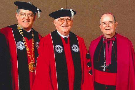 Dr. Joseph J. McGowan, president of Bellarmine University, Patrick Hart, O.C.S.O., and Archbishop Thomas Kelly during the ceremony at which Brother Hart received an honorary degree from Bellarmine University on May 10, 2003. (Courtesy of Bellarmine University)
