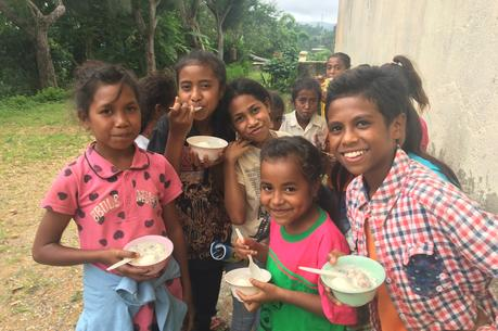 Feeding under nourished village children at Cacao, East Timor.  Photo by Michael Sainsbury.