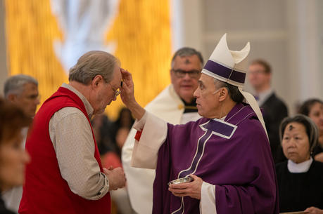 Cardinal Daniel N. DiNardo of Galveston-Houston, who is president of the U.S. Conference of Catholic Bishops, distributes ashes on Ash Wednesday at the Co-Cathedral of the Sacred Heart in Houston March 6, 2019. (CNS photo/James Ramos, Texas Catholic Herald)