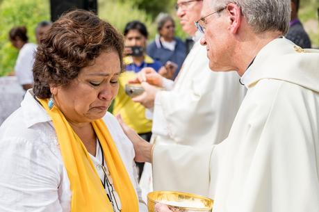 Father John I. Jenkins, president of the University of Notre Dame in Indiana, comforts a woman while distributing Communion during Mass on Oct. 15 with the Colectivo Solecito near Veracruz, Mexico. (CNS photo/Matt Cashore, University of Notre Dame)