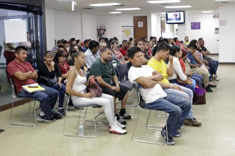 Mexican nationals at the Mexican Consulate General in Miami, which is offering legal assistance centers in response to President Donald Trump's measures to deport undocumented migrants. (AP Photo/Alan Diaz)