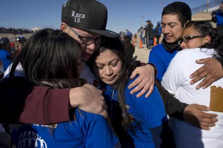 "Family members embrace in El Paso, Texas, during a massive reunion called ""Abrazos, No Muros"" (Hugs, Not Walls) on Jan. 28. (CNS photo/David Maung)"