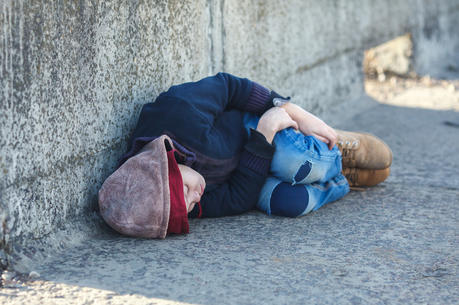 The challenge of finding families for homeless youth and for those in group shelters is creating the latest flashpoint over competing civil rights claims. (iStock/bodnarchuk)