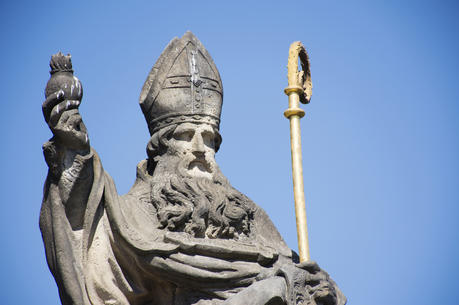 A St. Augustine statue at the Charles Bridge crossing the Vltava River in Prague, Czech Republic. (iStock/Tuayai)