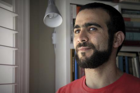 Former Guantanamo Bay prisoner Omar Khadr, 30, is seen at a home in Mississauga, Ont., on July 6. (Colin Perkel/The Canadian Press via AP)