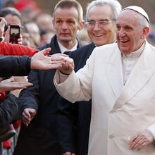 Pope Francis smiles as he meets the faithful during his pastoral visit to the parish of Ognissanti in Rome.