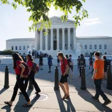 People gather outside the U.S. Supreme Court on June 26 in Washington. (CNS photo/Jim Lo Scalzo, EPA)