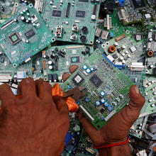 "A man in Karachi, Pakistan, retrieves circuit boards from discarded computer monitors Aug. 16, 2017. An economic system lacking any ethics leads to a ""throwaway"" culture of consumption and waste, Pope Francis said in a speech addressed to members of the Council for Inclusive Capitalism during an audience at the Vatican Nov. 11. (CNS photo/Akhtar Soomro, Reuters)"