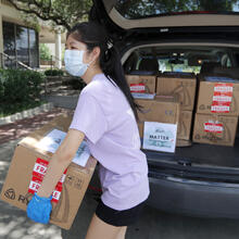 Valerie Xu, 15, delivers a donation, boxes of mask to UT Southwestern Medical Center in Dallas, Friday, June 5, 2020. Xu is among teens across the U.S. who decided to take action as the coronavirus pandemic took hold, doing everything from delivering groceries to older people to offering online tutoring, to emailing sick children and to raising money to help feed the hungry. (AP Photo/Tony Gutierrez)